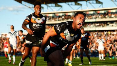 Roar power: David Nofoaluma brings the fans to their feet with a try to level the scores.