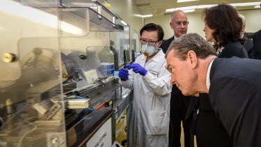 Industry minister Christopher Pyne visits  Trajan Scientific and Medical as the government faces pressure to support the car industry.
