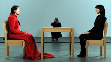 Marina Abramovic, present with a visitor.