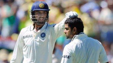 Ishant Sharma congratulates Virat Kohli on his 100 runs against Australia in the Adelaide Test on January 26, 2012.