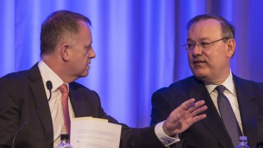 QBE chief executive John Neal and chairman Marty Becker at the company's AGM in Sydney on Wednesday.