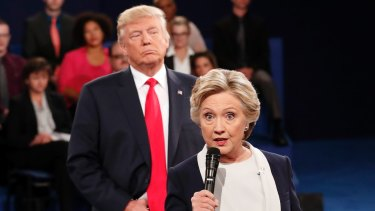 """Donald Trump """"towered behind"""" Hillary Clinton as she answered some questions during the second debate."""
