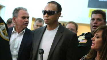 Tiger Woods leaves court in Florida after pleading guilty.
