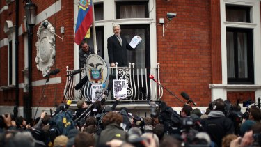 Assange speaks from the balcony of the Ecuadorian embassy in February.