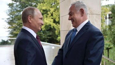 Russian President Vladimir Putin, left, and Israeli Prime Minister Benjamin Netanyahu shake hands in Sochi, Russia.