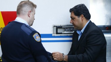 Adeel Khan arrives at court in June during his trial.