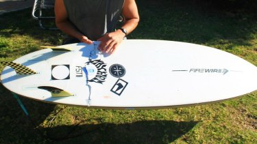 The board was left ripped following Mr Penman's close call with the shark.