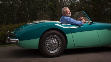 Frank Robson in the restored 1958 Austin-Healey 100-6 roadster, painted Pacific Green over Forest Green.