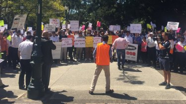 "Taxi drivers protest ""illegal taxi services"" outside Parliament in Brisbane."