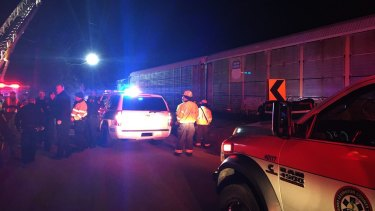 Emergency responders work at the scene of a crash between an Amtrak passenger train and a freight train in Cayce, South Carolina.