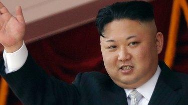 North Korean leader Kim Jong-un waves during a military parade in Pyongyang, North Korea.