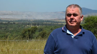 Peter Brown's property is surrounded by coal mines, but he is unable to require the mines to buy him out due to NSW's mining land acquisition policy.