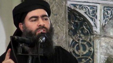 Wanted: Islamic State group chief Abu Bakr al-Baghdadi, who has a $US10 million price on his head, delivers a sermon at a mosque in Iraq in July.