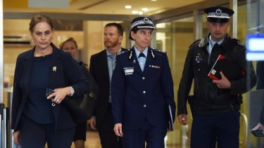 NSW Police Deputy Commissioner Catherine Burn, centre, leaves after giving evidence at the Lindt cafe siege inquest on Tuesday.