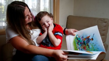 """""""We try to do it everyday"""": Rebecca Armodoros reading to her son Noah, 4, who will begin school soon."""