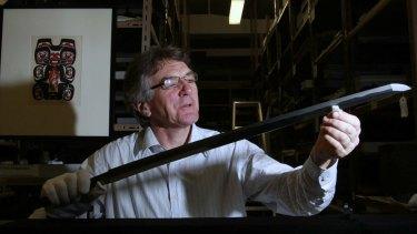 Australian Museum curator Colin MacGregor oils the sword given to Professor Edgeworth David by Lieutenant Shirase.