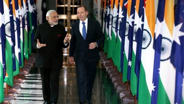 Playing the game: Indian Prime Minister Narendra Modi and Prime Minister Tony Abbott depart the House of Representatives.