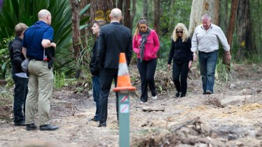Faye and Mark Leveson inspecting the area where police have been searching for the remains of their son Matthew.