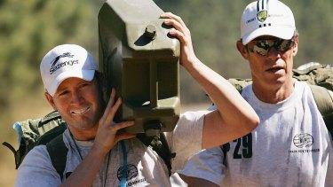 No love lost: Michael Clarke and former coach John Buchanan.