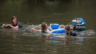 Dylan, Riley, and Jack take a dip in the Yarra River at Warrandyte Bridge.