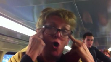 Remorseful: Footage posted on Youtube shows Karen Bailey during her racist rant on a train.