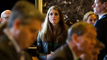 Hope Hicks watches from the sidelines at a Donald Trump press conference.