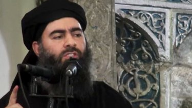 """Leader of the Islamic State group, Abu Bakr al-Baghdadi, reportedly announcing his """"caliphate"""" at the al-Nuri Mosque in Iraq."""