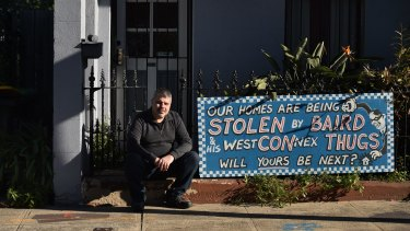Disgruntled owner Richard Capuano with a protest sign outside his St Peters home.
