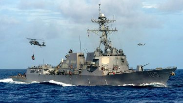 "The USS Dewey conducted a ""man overboard"" exercise near Mischief Reef on Thursday."