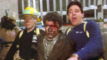 New York City rescue personnel help an injured businessman away from the 1993 World Trade Centre attack.
