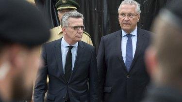 German Interior Minister Thomas de Maiziere and Bavaria's Interior Minister Joachim Herrmann arrive at the crime scene.