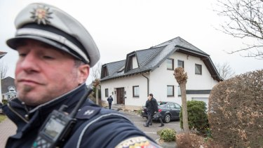 Police stand in front of the residence of the parents of Andreas Lubitz, co-pilot on Germanwings flight 4U9525, on March 26, 2015 in Montabaur,