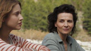 Lou de Laage and Juliette Binoche in <i>The Wait</i>.