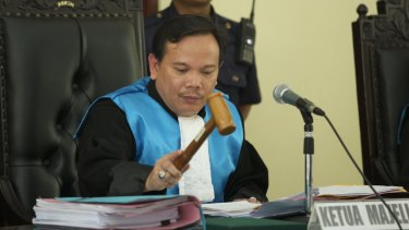 Decision: The Chief Judge of a three judge panel bangs his gavel after ruling on an appeal by lawyers for two of the Bali Nine drug smugglers.