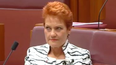 Pauline Hanson rolls her eyes during the maiden speech by One Nation Senator Malcolm Roberts.