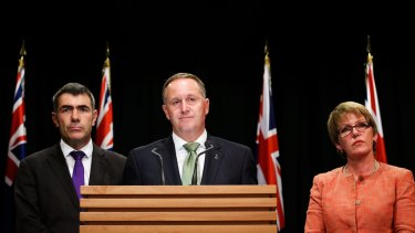 New Zealand Prime Minister John Key talks about the Fonterra threat while Minister for Primary Industries Nathan Guy, left, and Food Safety Minister Jo Goodhew look on.