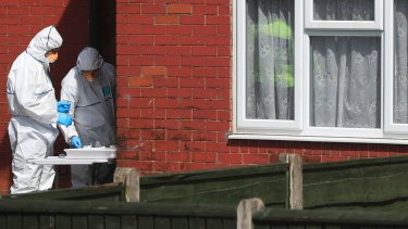 Police forensic investigators search a Fallowfield, Manchester  property linked to the Abedi family.
