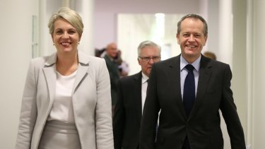 Tanya Plibersek and leader Bill Shorten arrive for the Labor caucus meeting on Friday.