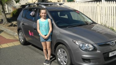 Nine-year-old Ella Crabb earns a percentage of her Dad's Car Next Door earning made by renting the family's West End car.