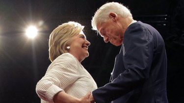 Hillary Clinton greets her husband, former president Bill Clinton.