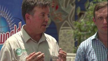 Dreamworld's senior wildlife handler Al Mucci with Environment Minister Steven Miles.