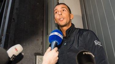 Mohamed Abdeslam addresses the media at his house in the Molenbeek neighborhood in Brussels.