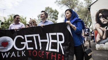 Celebrating diversity: Cultural groups came together for the National Day of Unity walk on Saturday.