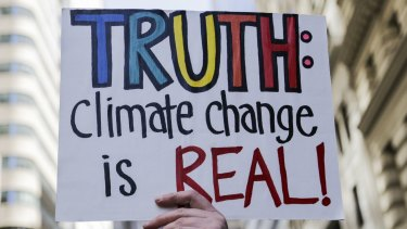 """A demonstrator holds a sign during the """"March For Truth"""" protest at Foley Square in New York on Saturday."""