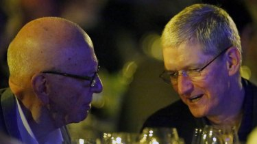 Apple CEO Tim Cook (right) with Rupert Murdoch, executive chairman of News Corp.