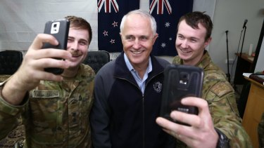 Prime Minister Malcolm Turnbull appears in selfies with Lieutenant Joshua Armstrong, 26, and Lance Corporal Lincoln Pade, 22, during his visit to Taji Military Complex in Iraq.