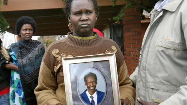 Martha Ojulo holds a photo of her son, Liep Gony.