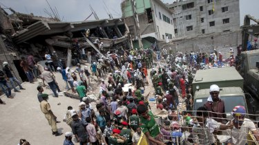 Rescue workers and volunteers search by hand for victims amongst the debris of the collapsed Rana Plaza building in Dhaka, Bangladesh, on April 26, 2013.