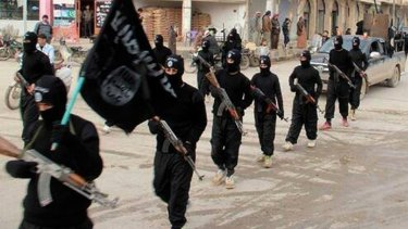 Islamic State fighters march in Raqqa, Syria in 2014.
