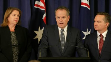 Opposition Leader Bill Shorten, flanked by opposition health spokeswomen Catherine King, and shadow treasurer Chris Bowen on Tuesday.